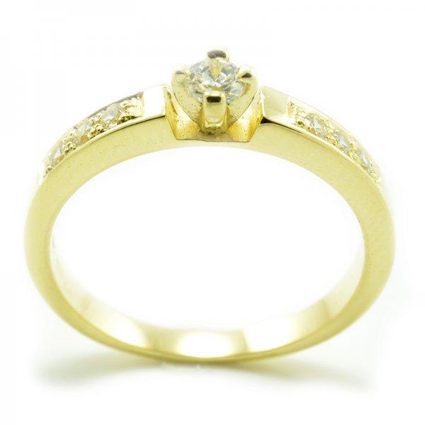 Zásnubný prsteň zo žltého zlata - 6 zirkónov po šíne prsteňa plus jeden centrálny Merry